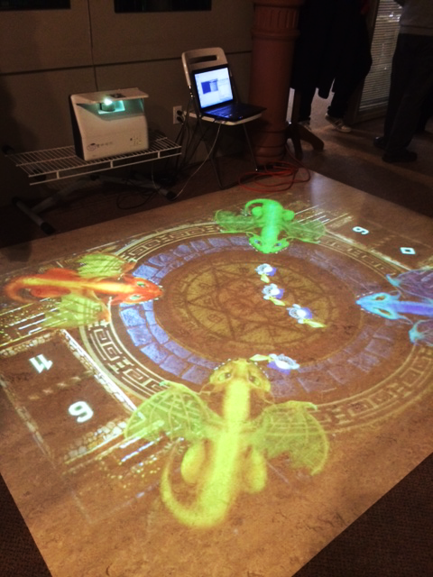 PO-MO Inc., another Innovation Alley success story, shows off one of its interactive floor projections at its Albert Street office