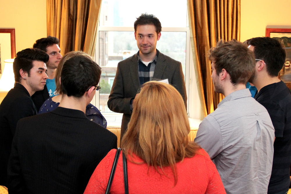 Reddit co-founder (and now chairman) Alexis Ohanian (centre) chats with a group of Waterloo Region startup entrepreneurs in New York in April, 2013. (Communitech News photo: Anthony Reinhart)