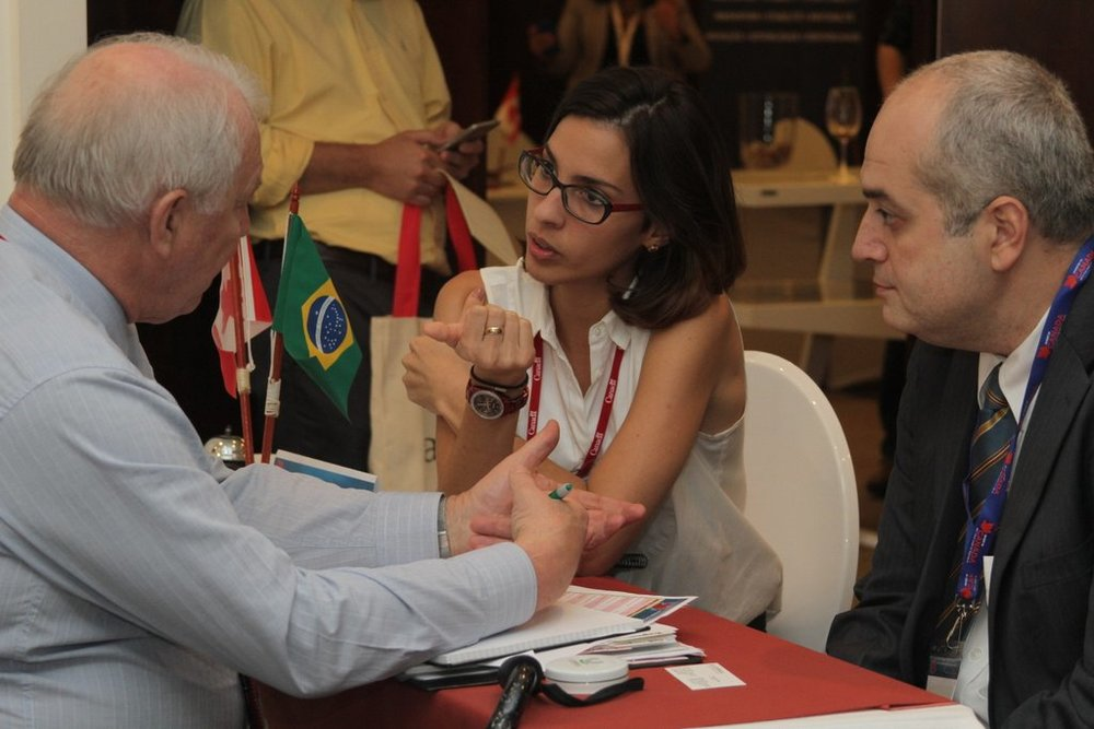 Michael Darch (left), President of CCCA, talking to Brazilian company at B2B session.  (Photo credit: Invest in Canada)