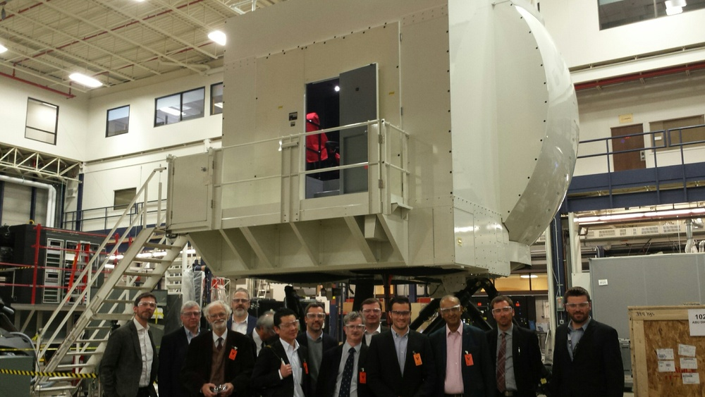 Foreign journalists in front of the CAE Simulator (Photo credit: Montreal International)