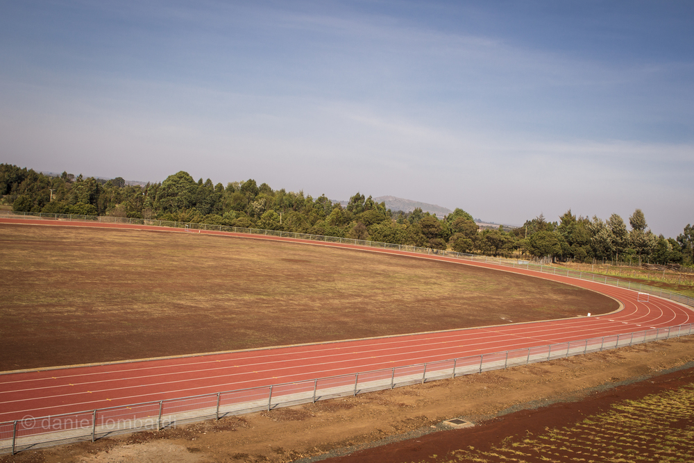Completed in early 2014, Lornah Kipligat's new all weather track in Iten has yet to see much use. A fee of 250KES ($3) is charged to anyone not staying at Kipligat's running lodge and that's been enough to keep most locals away.   If you're staying at the HATC then by all means, get a few workouts in on this puppy and enjoy not being caked in dust! However, if you want the real Iten experience you won't find it here.   I was visiting at the same time as Mo Farah and one of his coaches told me that Mo did his key workouts on the all weather track but strongly preferred to run on the dirt one with everyone else if he could. Why come all the way to Kenya if you're just going to train by yourself on an all weather track?!