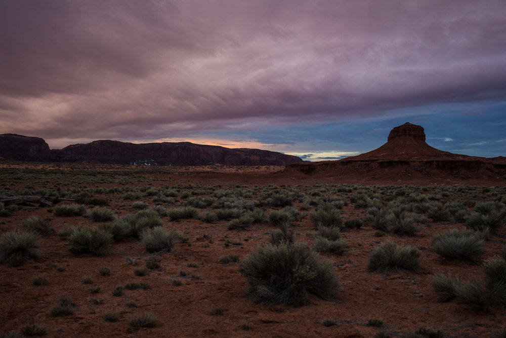 The start of the day glows over Monument Valley. The place is an international tourist destination and an iconic symbol of the American West. For those who live there, Monument Valley is a sacred and spiritual place. But it's also a very dry place.