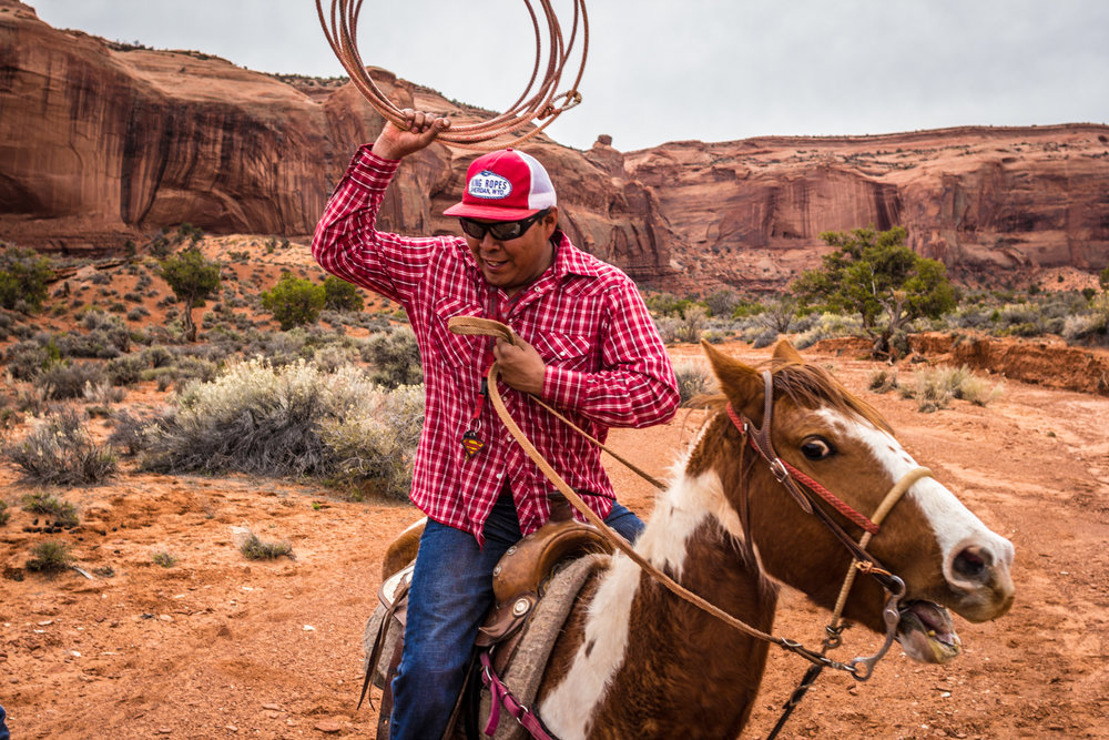 Will Yazzie goofs around on his horse in Monument Valley as he takes me to where residents of the valley could fetch water historically... perhaps prehistorically.