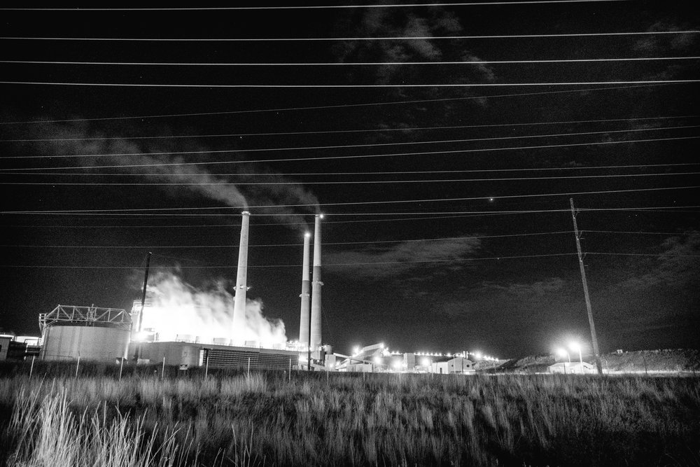 The coal plant smoke stacks, emitting greenhouse gases 24/7, are the tallest man-made structures in all of Montana and impose themselves subtly on the skyline from anywhere around the small town of Coalstrip.