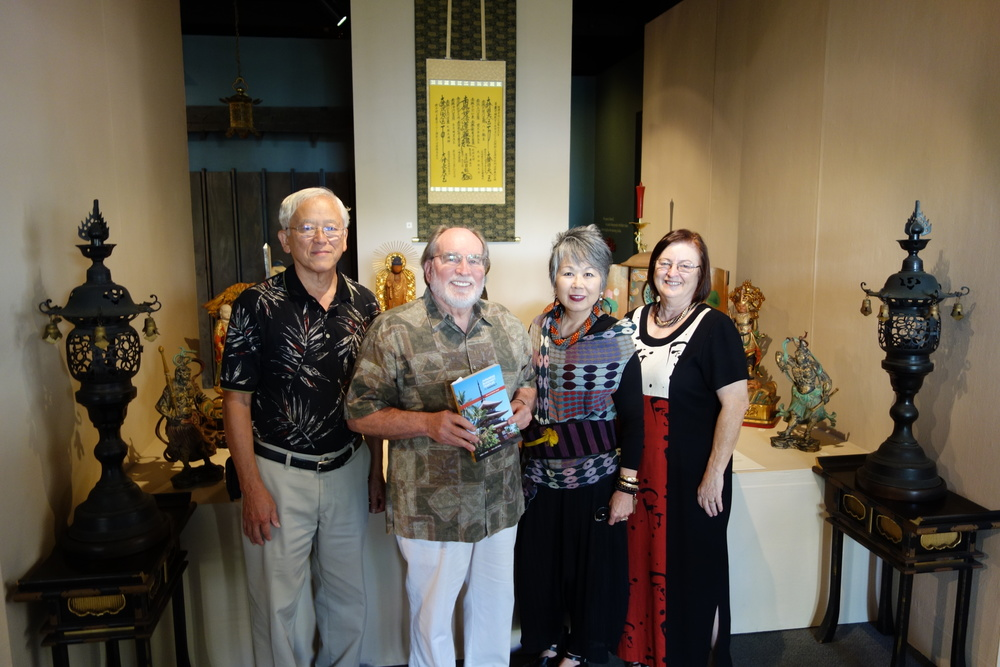 Governor Neil Abercrombie visiting the Buddhist Temple Exhibition at the Japanese Cultural Center of Hawaii on February 16, 2013.  Left to right: George Tanabe, Gov. Abercrombie (holding copy of guidebook), Carole Hayashino (President of JCCH), and Willa Tanabe.