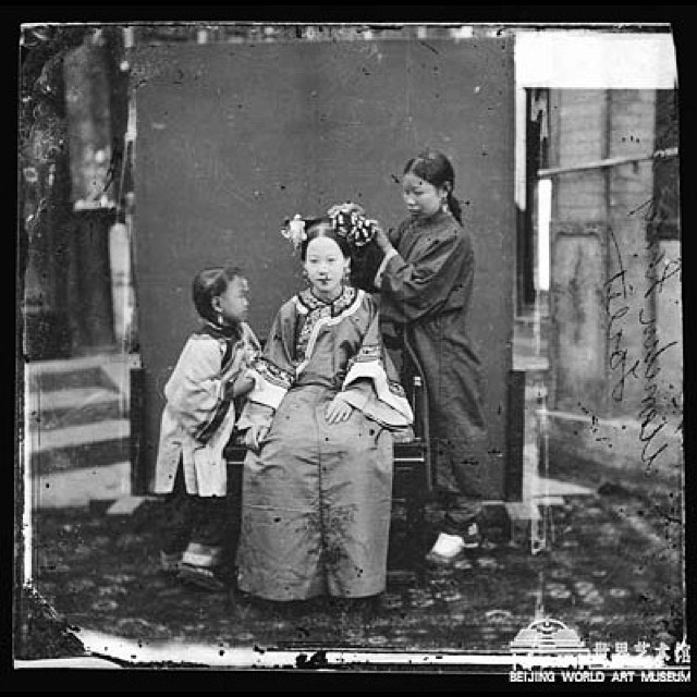 "John Thomson (1837 – 1921) was a pioneering Scottish photographer, geographer and traveler. He was one of the first photographers to travel to the Far East, documenting the people, landscapes and artifacts of eastern cultures. Upon returning home, his photographs among the streets of London cemented his reputation, and is regarded as a classic instance of social documentary which laid the foundations for photojournalism. He went on to become a portrait photographer of High Society in Mayfair, gaining the Royal Warrant in 1881. In April 1862, Thomson left Edinburgh for Singapore, beginning a ten-year period spent travelling around the Far East. He established a photographic studio in Singapore. After visiting Ceylon and India from October to November 1864 to document the destruction caused by a recent cyclone, Thomson sold his Singapore studio and moved to Siam. After arrival in Bangkok in September 1865, Thomson undertook a series of photographs of the King of Siam and other senior members of the royal court and government. Thomson returned to England in 1872, settling in Brixton, London and, apart from a final photographic journey to Cyprus in 1878. Over the coming years he proceeded to lecture and publish, presenting the results of his travels in the Far East. His publications started initially in monthly magazines and were followed by a series of large, lavishly illustrated photographic books. He wrote extensively on photography, contributing many articles to photographic journals such as the British Journal of Photography. He also translated and edited Gaston Tissandier's 1876 History and Handbook of Photography, which became a standard reference work. In recognition of his work, one of the peaks of Mount Kenya was named ""Point Thomson"" on his death in 1921. That same year, Henry Wellcome acquired a collection of glass negatives, totaling over 600, that were owned by Thomson. Today they are in the collection of the Wellcome Library. Some of Thomson's work may be seen at the Royal Geographical Society's headquarters in London."