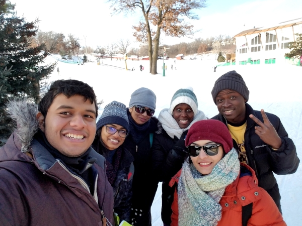 Emmanuel has learned to enjoy Minnesota winters! Here he is with some friends — out on the slopes!