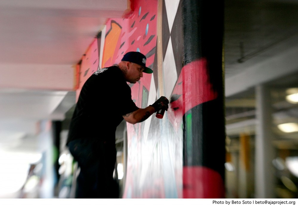 "Graffiti Artist Ryan Hoppe AKA Hasler One works on a collaborative mural during the ""Underground Art in the Underground"" event in the parking structure of Westfield Mission Valley Mall on Saturday March 22nd, 2014. The event was an initiative by The San Diego Cultural Arts Alliance, whose primary focus is to teach youth how to send positive messages through street art rather than graffiti."