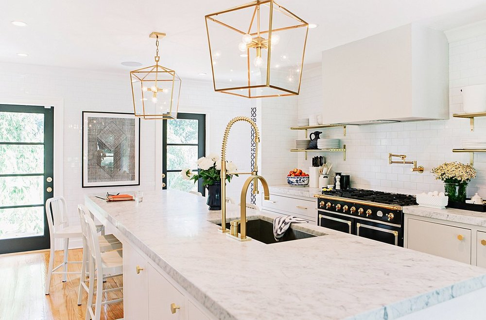 Love the ----- stove as the centerpiece of the otherwise clean and minimal kitchen design.