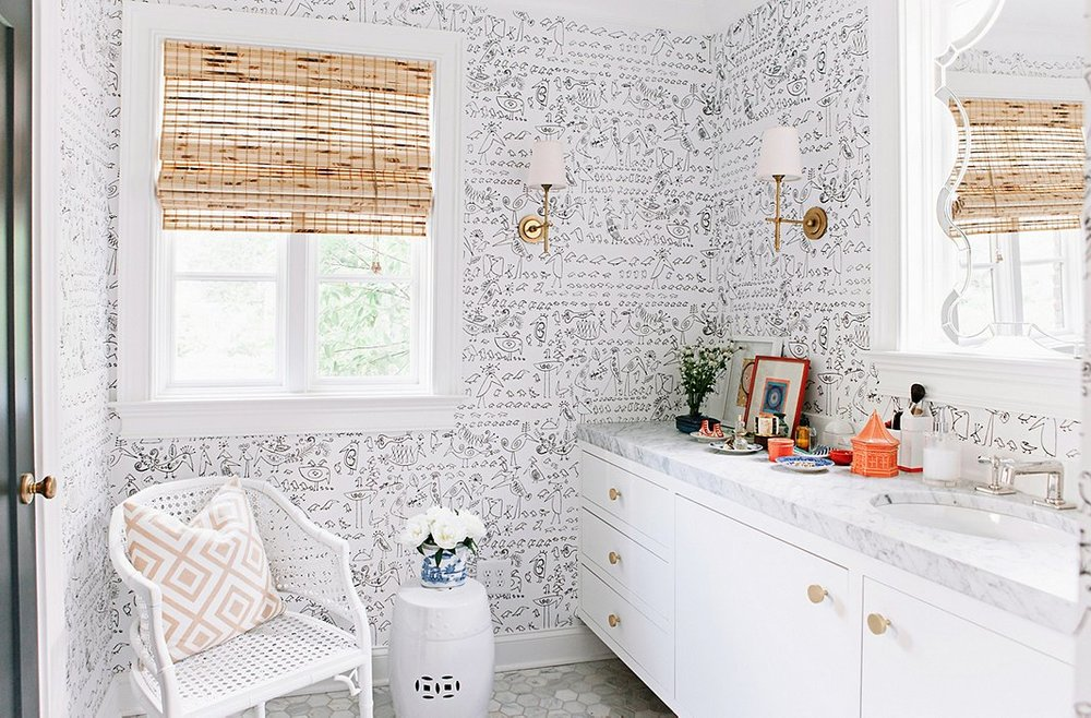 The wallpaper is just the right amount of wild to bring some character to the room.