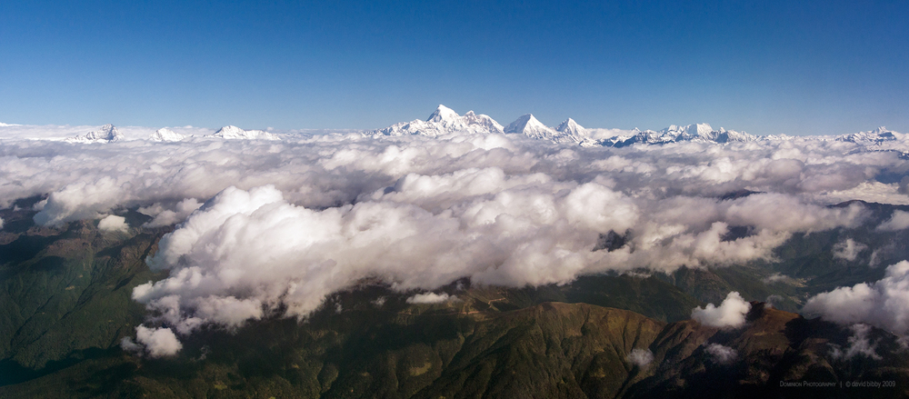 4 nations under cloud  - The peak at left is Kanchenjunga (8586m). The high peaks in the centre of the shot are Jomolhari (7314m), Jomolhari II (6935m), Jitchu Drake (6850m) and Tsheri Kang (6526m). Nepal and India, Bhutan and Tibet.