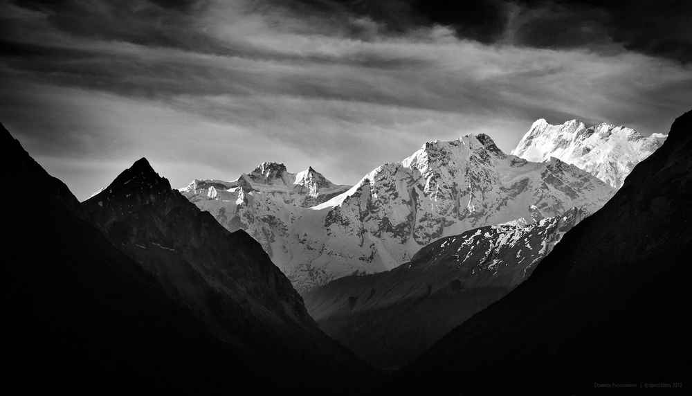 Simnang Himal (6251m) and the higher mountains at right are part of the Manaslu Himal. Manaslu Conservation Area.