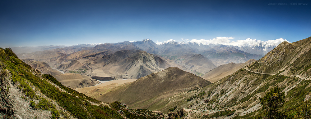 View of the Kali Gandaki Nadi valley from the Bhima Lojun La (4460m). Low point at center of horizon is Thorung La (5416m). The two highest snowy peaks are Tilicho Peak (left, 7134m) and Nilgiri (right, 7061m). Mustang district.