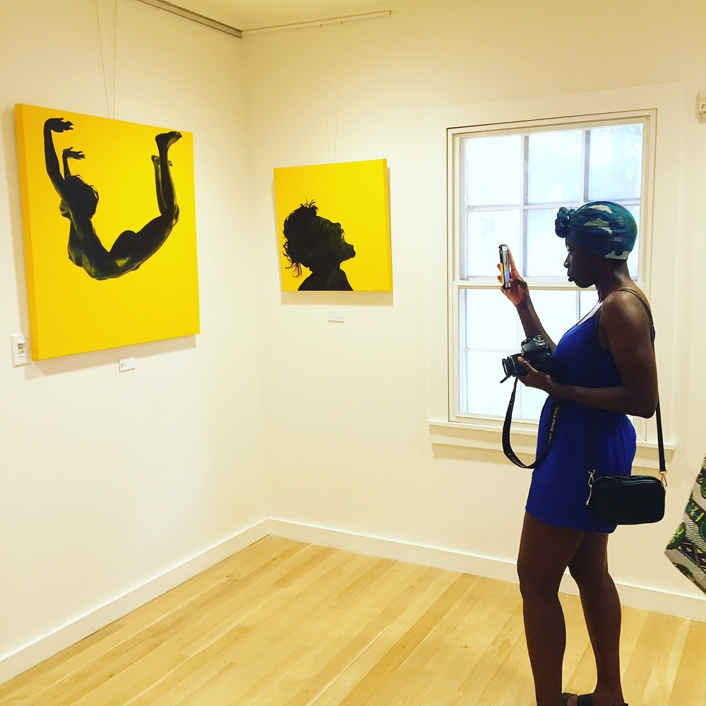 Doyin Oyeniyi taking a shot of Dawn Okoro's powerful and bold work!