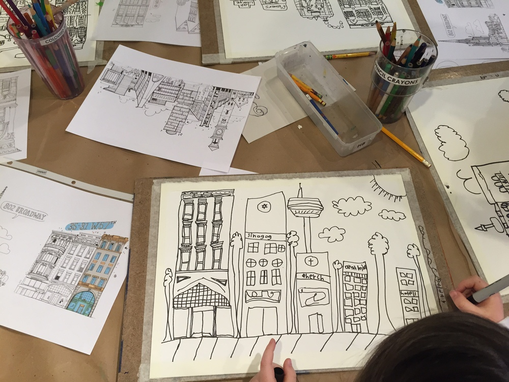 We wanted the kids to pay particular attention to the beauty in the details of urban architecture. We were blown away by the focus and enthusiasm they showed at this. All of the details had to be drawn in pencil first, then traced over with Sharpie and finally painted with coloured inks.