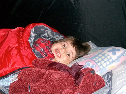I got a little teary eyed when this photo popped across my memolane..  She's so happy there.. I can remember that night..  It seems memolane serves mostly as a way to resurface my memories (via e-mail) that I then forward around to my friends and family.  This one of my daughter all cuddled up in her sleeping bag was just too cute. I had to share. http://bit.ly/NXtiGO