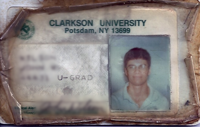 I found my old college ID badge at the bottom of some junk today. I was immediately transported back to that time. This thing was printed in the fall of 1991, the day I arrived on campus... nearly twenty years ago.. what?!! Look at that face. So young and innocent. Little did I know that a year from then my Dad would be dead, that I'd be without a safety net struggling with ROTC, keeping the grade, and my own self image. But here, in this picture, I'm still hopeful. I think that is a high school band shirt I'm wearing.. and giant glasses. What a NERD! Twenty years. It might as well be a hundred. That was a lifetime ago and, somehow, things have worked out for me. I thank God for all my blessings. P.S. Go Clarkson Golden Knights! http://clarkson.edu/