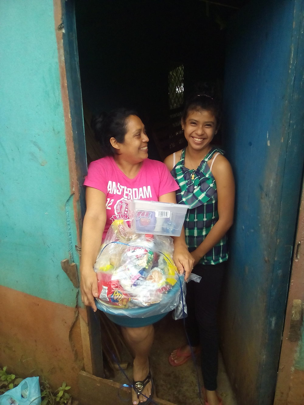 - Elizabeth (left) and Melisa (right). It was Melisa's birthday on that day. They were grateful for the basket, praise the Lord!