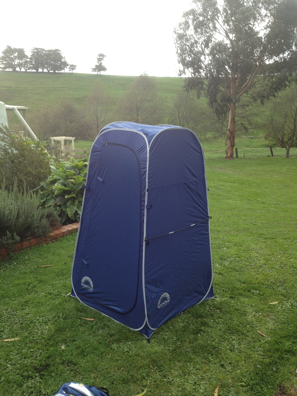 The camping shower tent that is the base of the mobile darkroom