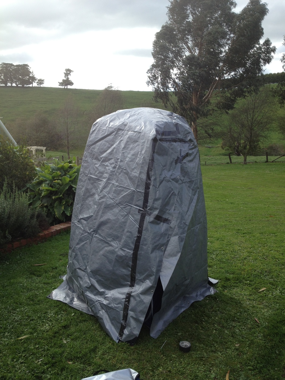 Taped up tarp cover to make the portable darkroom dark.