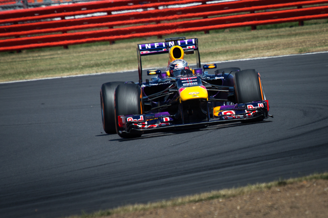 Sesbastian Vettel's RB9 exciting Luffield at the Silverstone Young Driver Test.