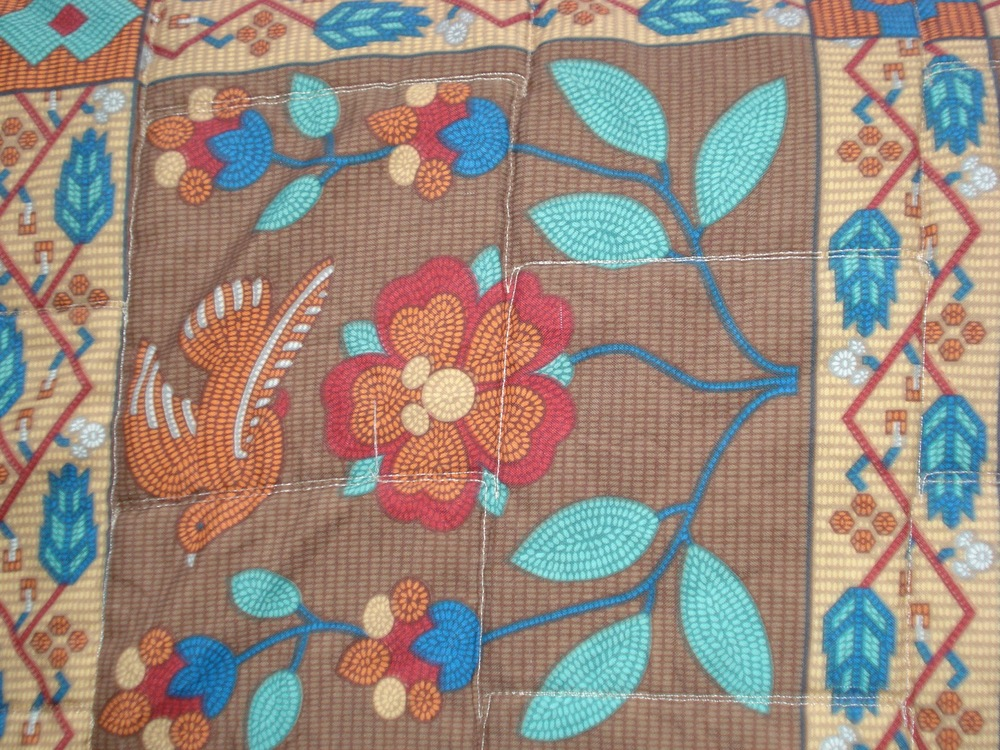 Look at the middle of the flower on this bedspread at Wilderness Lodge.