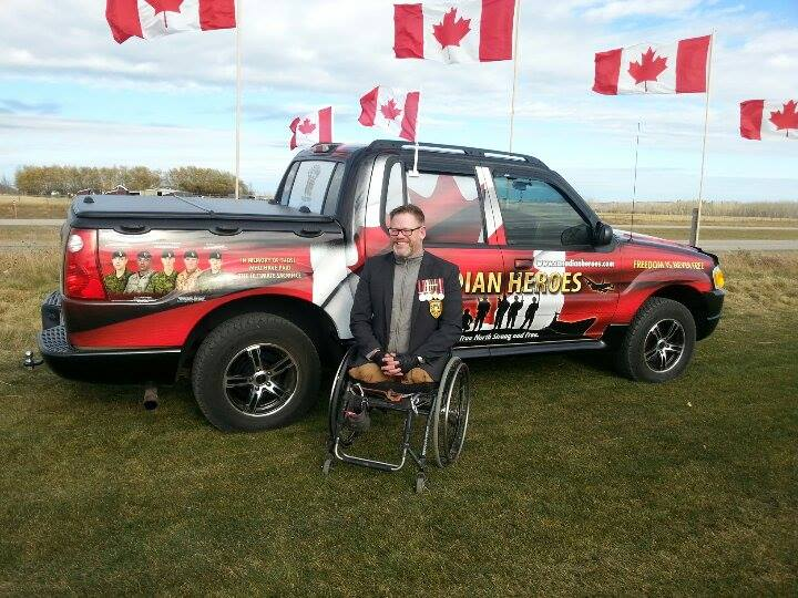 Master Corporal Paul Franklin with Don Fraser's Canadian Heroes Memorial Vehicle