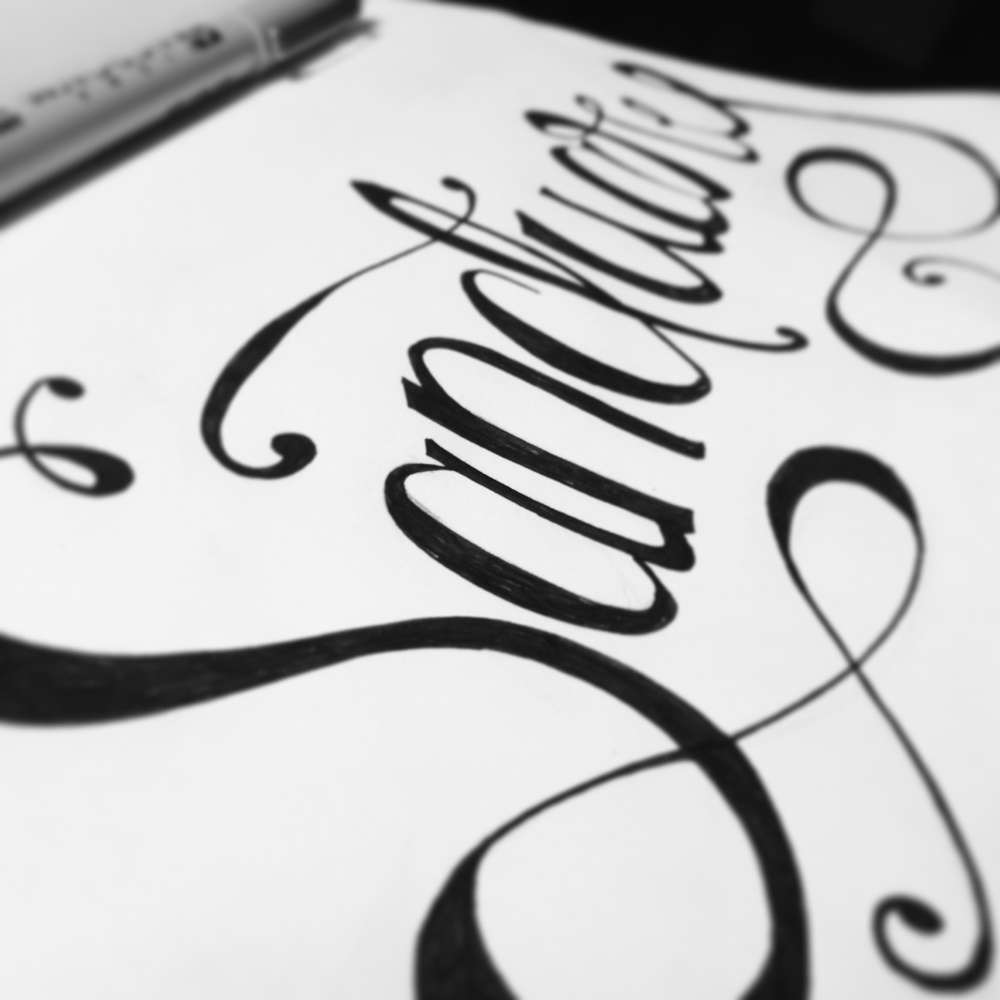 Sketching some hand lettering for a poster design.