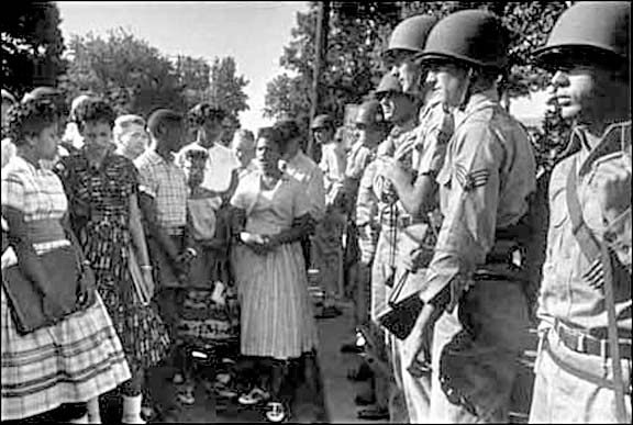 Arkansas National Guard troops block The Arkansas Nine from entering Little Rock Central High School in 1957, on the orders of Gov. Orval Faubus. image via dallasvoice.com