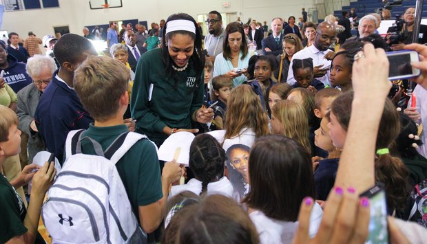 A'ja Wilson signing autographs for the younger kids on signing day. image via The State Newspaper. credit: Tracy Glantz