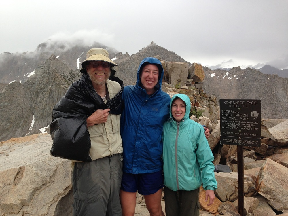 JMT hikers Martha and Kate on Kearsarge Pass on a stormy, cold July 15th with Dr. John Wehausen, founder of the Sierra Nevada Bighorn Sheep Foundation.