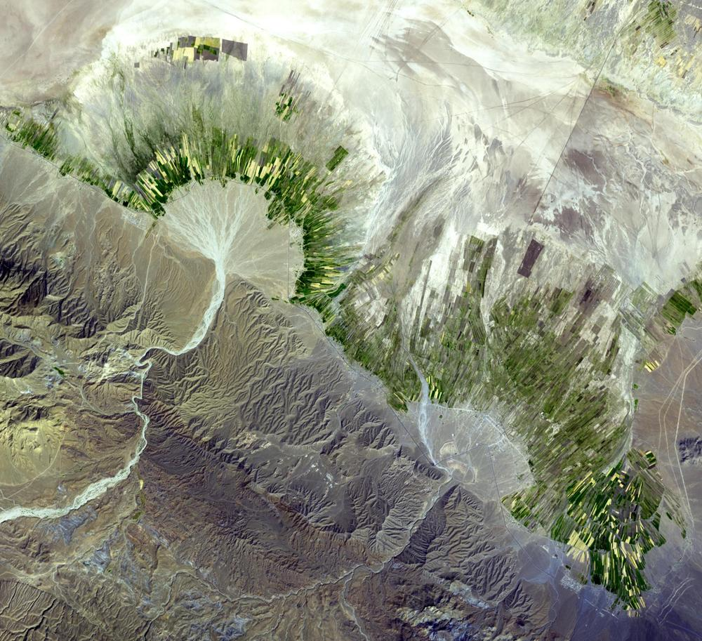 The  latest Where on Google Earth image  featured a gorgeous alluvial fan in the Zagros mountains of Iran. The Google Earth imagery does not show this fan in flood, but an ASTER image from a few years ago does.  