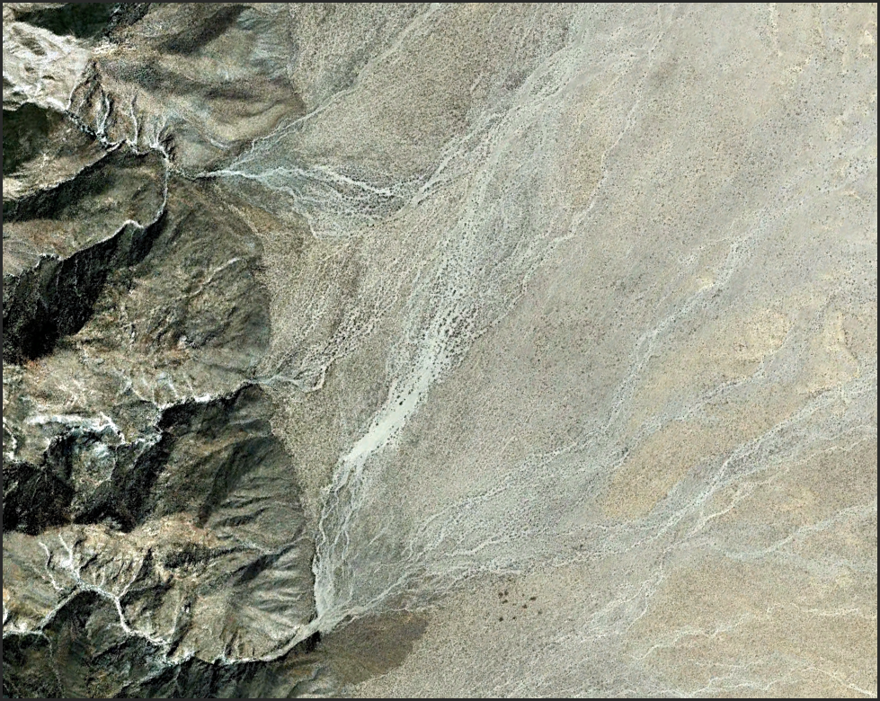 Alluvial fan floods...maybe not so pathological...but pathologically hard to manage and mitigate. I am currently working on a career-long project that deals with these little monsters and I would appreciate some help finding stellar examples of such events anywhere in the world. For example, this one I have posted of a significantly channel modifying flood in Baja California. Look in particular for evidence of channel avulsion on fans or, better, fan floods that appear to have not paid much attention to the pre-flood distributary channel array. My goal is to find representatives of a potential continuum of geomorphic responses to large floods or debris flows on alluvial fans in a range of physiographic settings.  