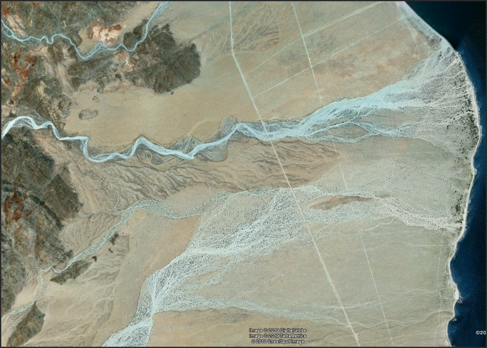 Another nice example of the effects of a large flood on an alluvial fan. Link below, but GE image better.     http://www.flashearth.com/?lat=29.941035&lon=-114.499101&z=13.9&r=0&src=msa