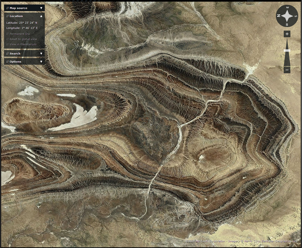 Here is a second image from the Tanezrouft showing multiple folding of Palaeozoic sediments. It also shows a number of water gaps through the cuestas.   The flashearth image is  here .  It was also Ron's choice for  Where on (Google) Earth #66 .