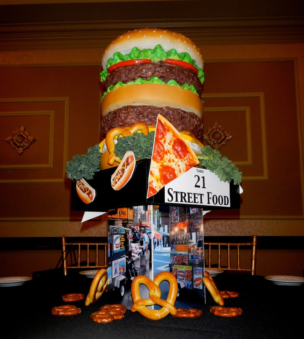 Our client wanted street food to be represented in one of the tables. We used our giant hamburger, along with images of street food carts and fresh food accents.