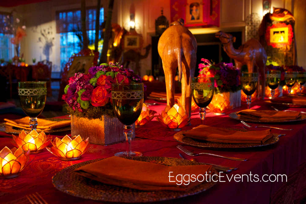 Moroccan tablescape including Eggsotic's camels and capiz lotus flower candle holders.