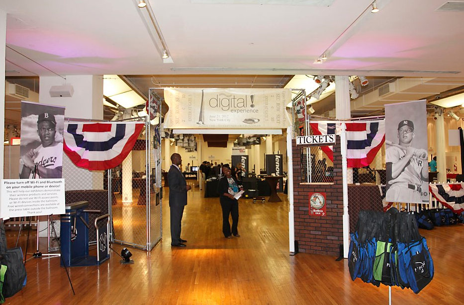 The entry display featured American flag bunting, vintage baseball banners, and a custom ticket booth.