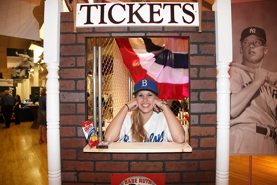 Our custom ticket booth with a Pepcom event staff member. They thought of everything, even sunflower seeds!