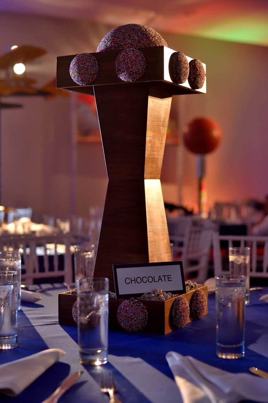 The guest of honor loves chocolate, specifically nonpareils, also known as Sno-Caps. We had lots of fun creating custom extra-large nonpareils to represent his favorite candy.
