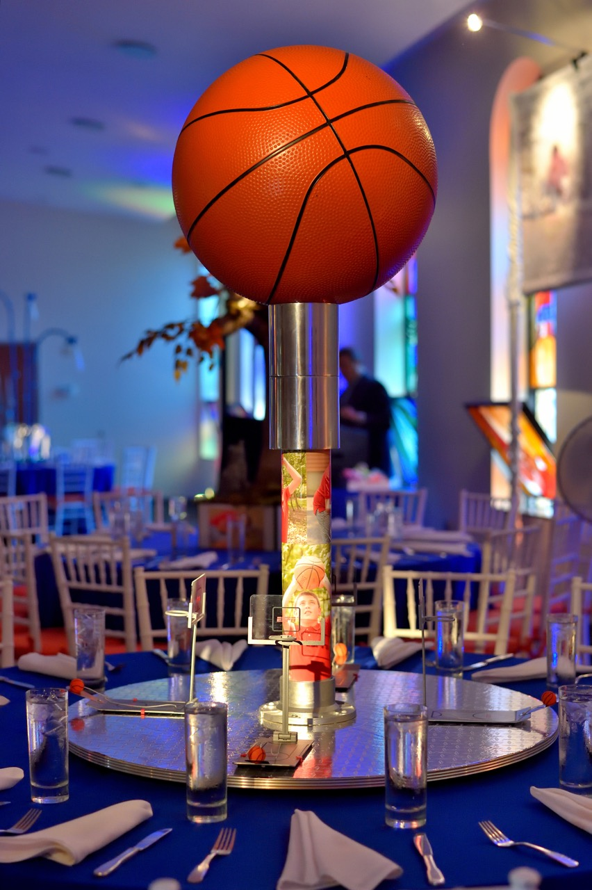 This interactive basketball centerpiece has a rotating foundation with four mini basketball games for guests to play. The guest of honor loves basketball, but it was emphasized that he loves playing it, not watching it on TV. We made sure that this centerpiece reflected that.