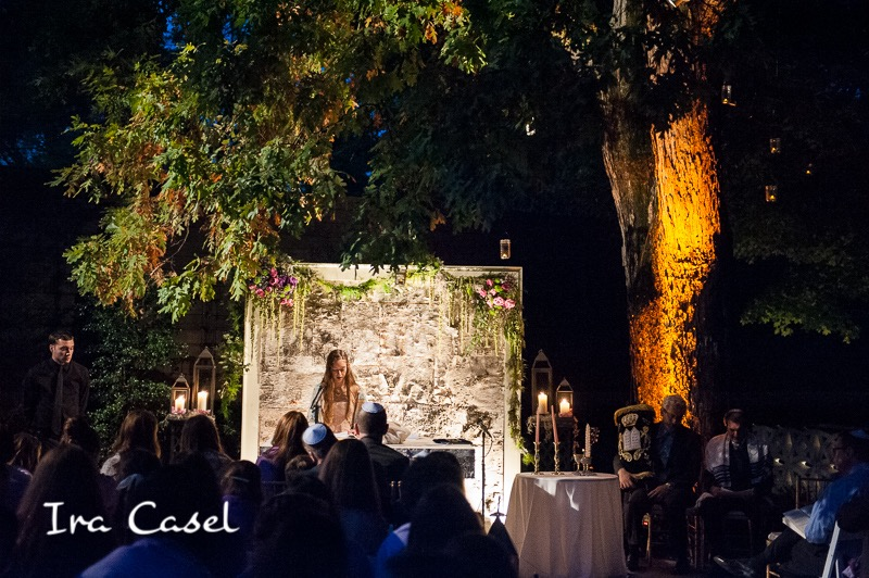 Birch wall and ceremony lighting by Eggsotic Events. Photo by Ira Casel