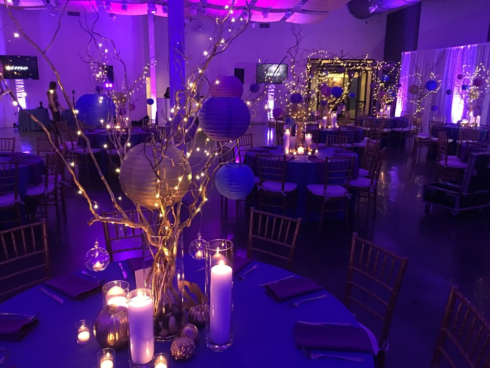 Gold paint brightened these branches in the centerpieces of this late-fall Bat Mitzvah. The lanterns and lights kept the fun care-free feeling of being a kid while the candles and votives introduced the right elegance into the night.