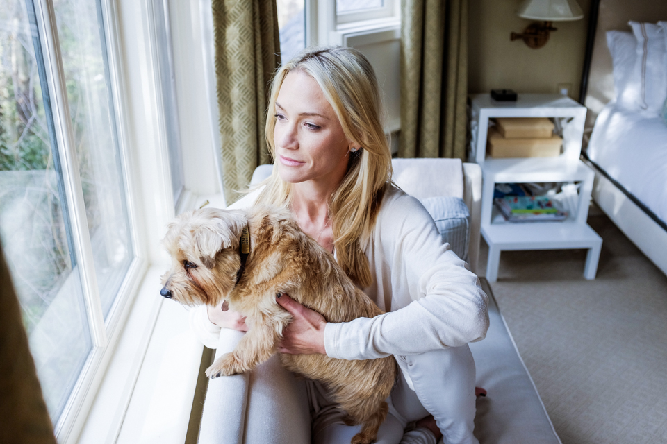 Kirsten in her bedroom with her faithful dog Tattersall.