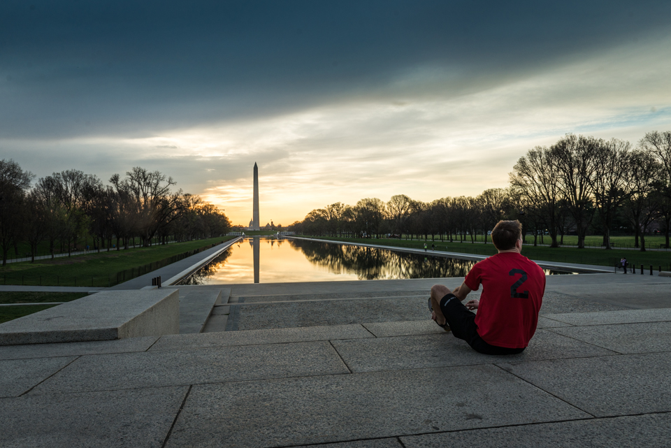 Dan Dzombak stretching before a run at sunrise on the National Mall, shot for Destination DC's  DC Cool  campaign.