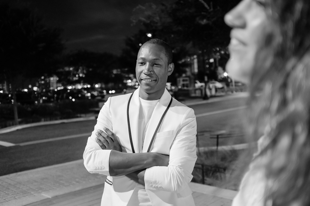 The Washington Post's Clinton Yates waits for his Uber, one of the event partners of Diner En Blanc.
