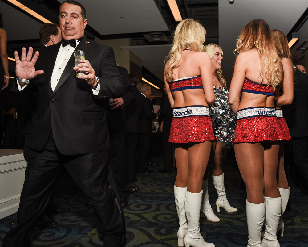 Washington Wizards cheerleaders mingled with guests during the Fight Night benefit cocktail hour before their performance later in the evening.
