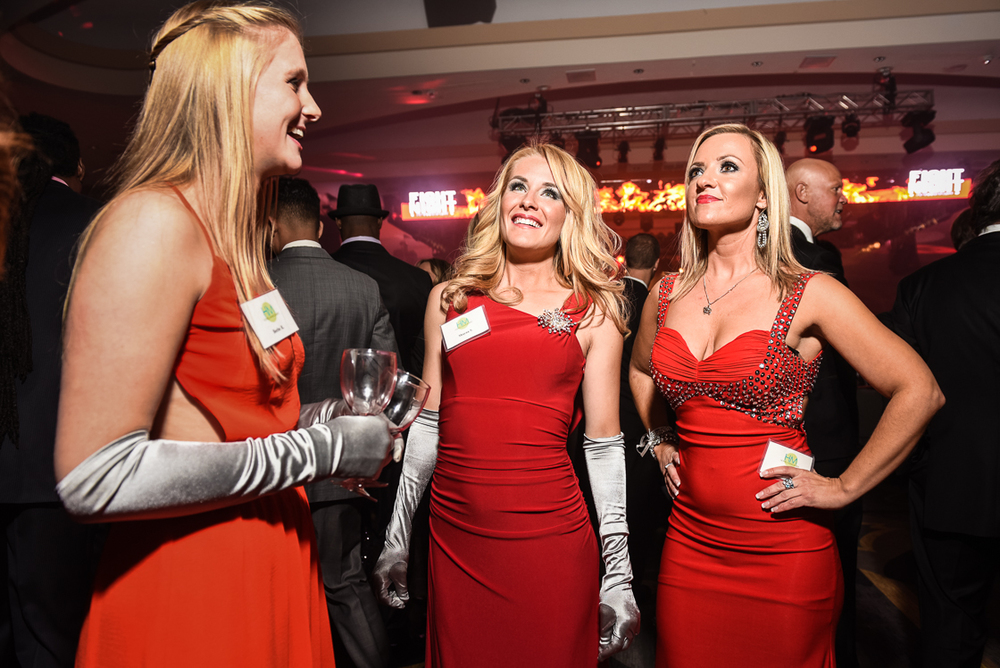 Guests were served by an all-female staff of cocktail waiteresses clad in red floor length gowns and optional elbow-length gloves.