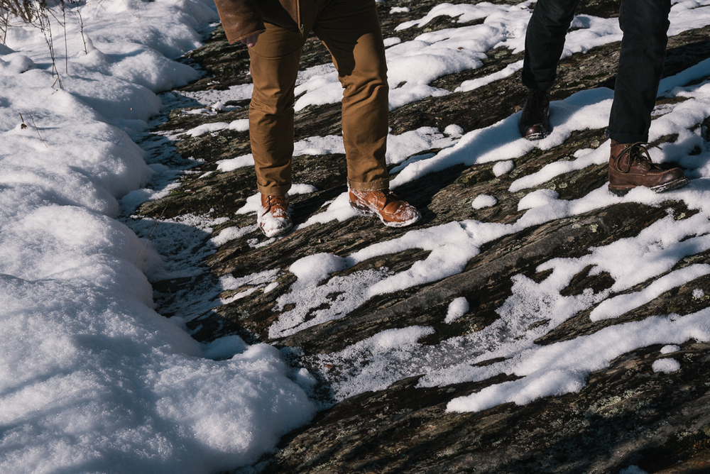 With classic menswear style, we tromped through the snow to a locals-only swimming hole called Triple Buckets, or the Potholes, named for the deep pools carved by a series of three waterfalls.