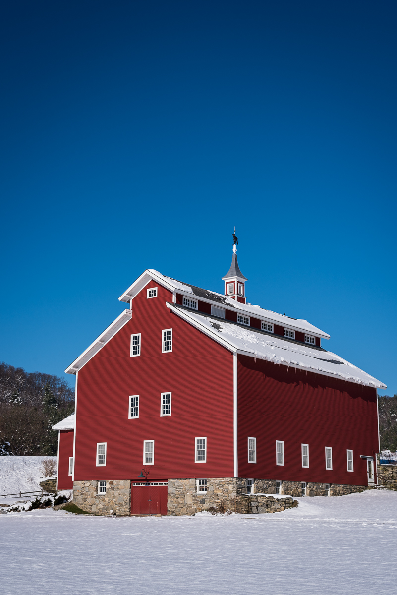The historic West Monitor Barn in Richmond, VT is one of my favorite places in my hometown. Constructed in 1903 by the Whitcomb family as part of their large family dairy farm, it eventually fell into disrepair after the farm was sold. The unique New England architecture made the barn worth saving, and it was reconstructed exactly as it had been. It now hosts events that benefit the Vermont Youth Conservation Corps, including some gorgeous weddings.